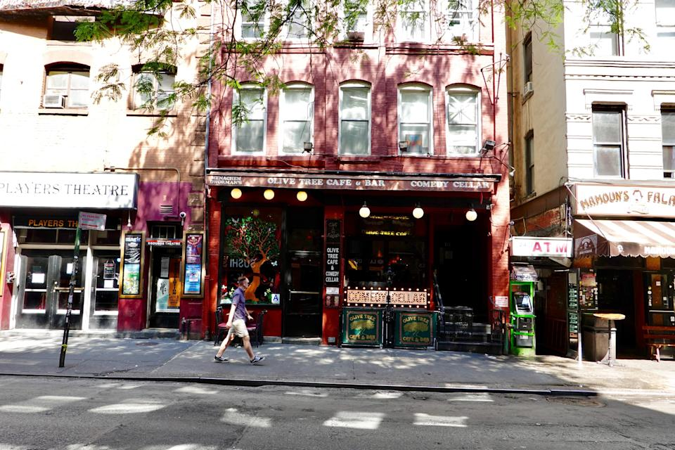 """<p><strong>Big picture: What's the vibe of the place, what's it like?</strong> You'll walk past the flashing lights of MacDougal Street to catch a show at the Comedy Cellar. None of the promoters shouting """"stand-up comedy tonight!"""" are trying to get you into the Cellar, where the show is already sold out. Stand-up partially originated here in the West Village of the 1950s, at coffeehouses where folk musicians and beatnik poets also performed. Later, blockbuster stars like Jerry Seinfeld and Eddie Murphy performed at the Cellar; if you're lucky, one may show up the night you're there.</p> <p><strong>What kinds of events can we see here?</strong> Stand-up comedy. Widely considered one of the best comedy clubs in the country, if not the best. Big names like Amy Schumer as well as local legends and new up-and-coming talent perform here.</p> <p><strong>How are the seats?</strong> Seating is intimate and close together, and there is a two-item minimum on food or drinks. It's 21-plus and vaccine-mandatory. Be prepared to surrender your phone at the door, too. There's no bad seat in the house, but sit in the front at your own risk of getting (playfully) heckled by the host or a comic.</p> <p><strong>Good for kids?</strong> No; the Comedy Cellar is a 21-and-over venue.</p> <p><strong>Anything in particular that makes this place special, from the programming to a unique feature it has?</strong> For a <a href=""""https://www.cntraveler.com/destinations/new-york-city?mbid=synd_yahoo_rss"""" rel=""""nofollow noopener"""" target=""""_blank"""" data-ylk=""""slk:New York"""" class=""""link rapid-noclick-resp"""">New York</a> stand-up comedy experience, you can't do better.</p> <p><strong>If we're going to be in town, what—and who—do you think this is best for?</strong> If you're looking to laugh on a fun night out, you're in the right place.</p>"""
