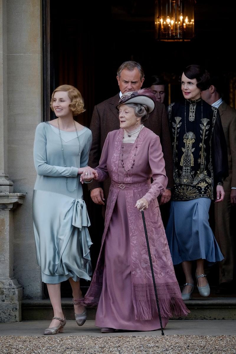 Cast of Downton Abbey exiting a building