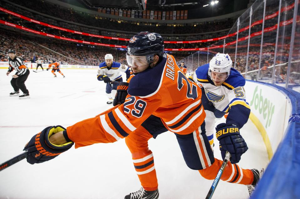 St. Louis Blues' Colton Parayko (55) and Edmonton Oilers' Leon Draisaitl (29) battle for the puck during second period NHL hockey action in Edmonton, Alberta, on Tuesday, Dec. 18, 2018. (Jason Franson/The Canadian Press via AP)