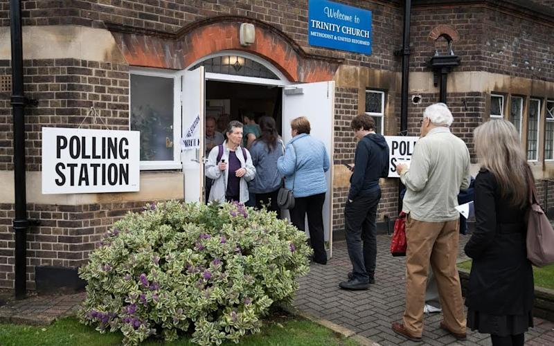 Voters queue to enter a polling station at Trinity Church in Golders Green  - Credit: Matt Cardy/Getty Images