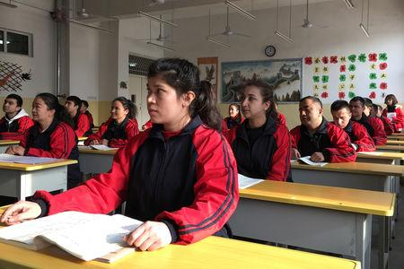 Residents at the Kashgar city vocational educational training centre attend a Chinese lesson during a government organised visit in Kashgar, Xinjiang Uighur Autonomous Region, China, January 4, 2019. PREUTERS/Ben Blanchard