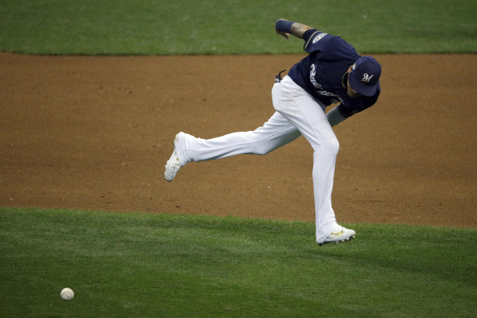 Milwaukee Brewers shortstop Orlando Arcia (3) is unable to reach the ball hit by Los Angeles Dodgers' Joc Pederson during the ninth inning of Game 2 of the National League Championship Series baseball game Saturday, Oct. 13, 2018, in Milwaukee. (AP Photo/Charlie Riedel)