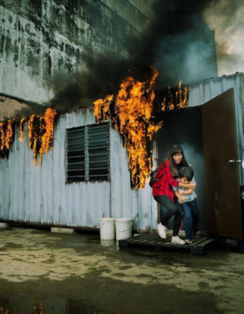 Sofia saving a boy from a burning shed
