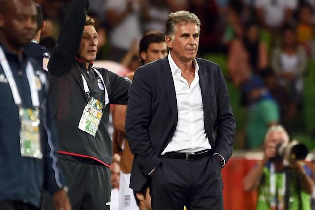 """Iran coach Carlos Queiroz (centre) resigned his post on Friday, citing external """"pressures"""" just six months after extending his contract until 2018 (AFP Photo/William West)"""