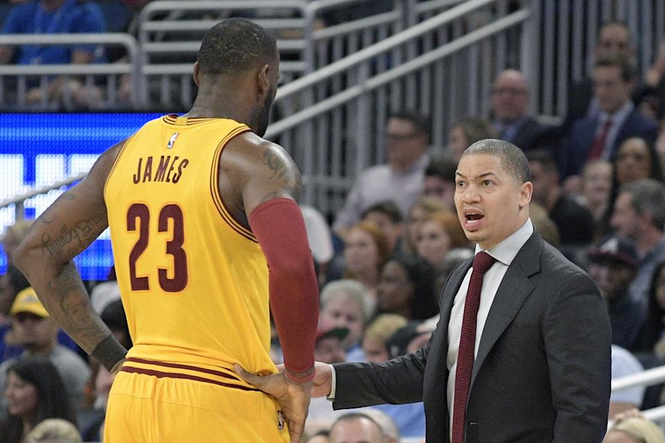Cavaliers coach Tyronn Lue talks with forward LeBron James during a game in 2017.