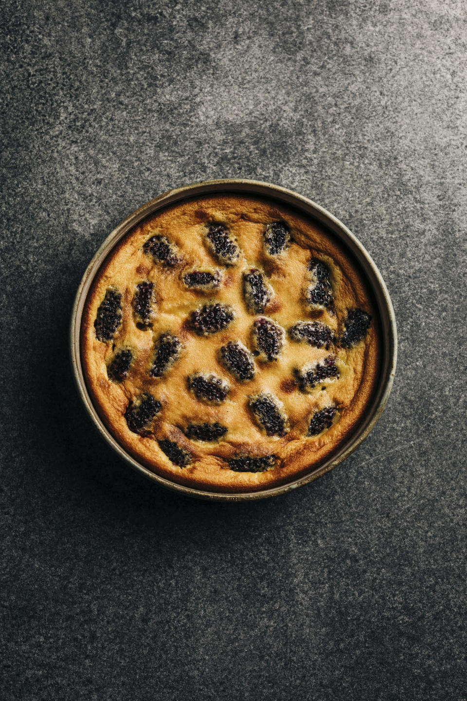 """This image released by Hardie Grant Books shows a recipe for Mulberry clafoutis from the cookbook """"How Wild Things Are: Cooking, Fishing and Hunting at the Bottom of the World,"""" by Analiese Gregory. (Adam Gibson/Hardie Grant Books via AP)"""