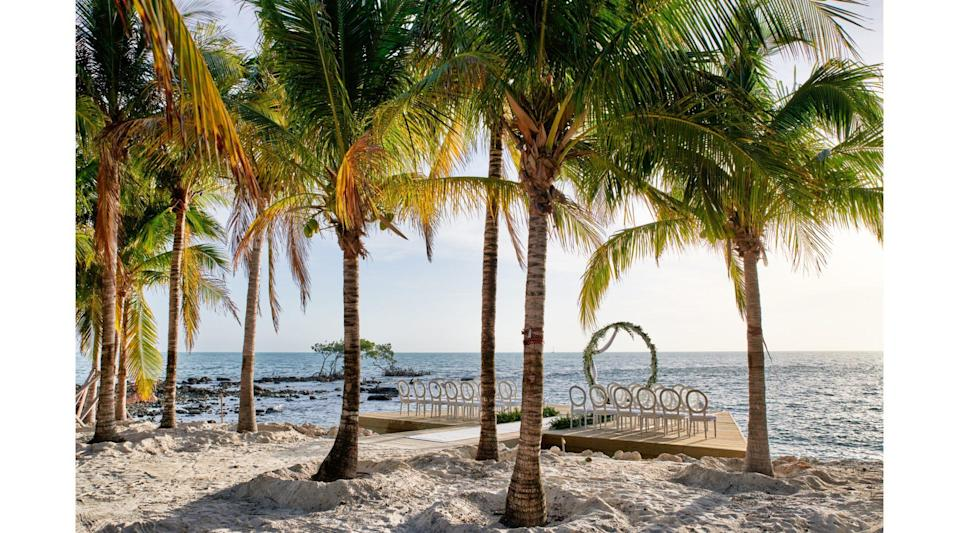 """<p>The Keys' newest private waterfront hotel, the 199-room <a href=""""https://www.islabellabeachresort.com/weddings/"""" rel=""""nofollow noopener"""" target=""""_blank"""" data-ylk=""""slk:Isla Bella Beach Resort"""" class=""""link rapid-noclick-resp"""">Isla Bella Beach Resort</a>, features 24,000 square feet of event space, four restaurants, five swimming pools, a marina, full-service spa, and soothing Greek- and Bermudian-inspired architecture surrounded by thousands of lush palms for the perfect backdrop to your wedding photos.</p>"""