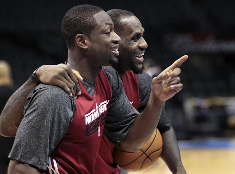 Miami Heat's Dwyane Wade, left, and LeBron James laugh during basketball practice Wednesday, June 13, 2012, in Oklahoma City. Game 2 of NBA finals between the Heat and the Oklahoma City Thunder is Thursday. (AP Photo/Sue Ogrocki)