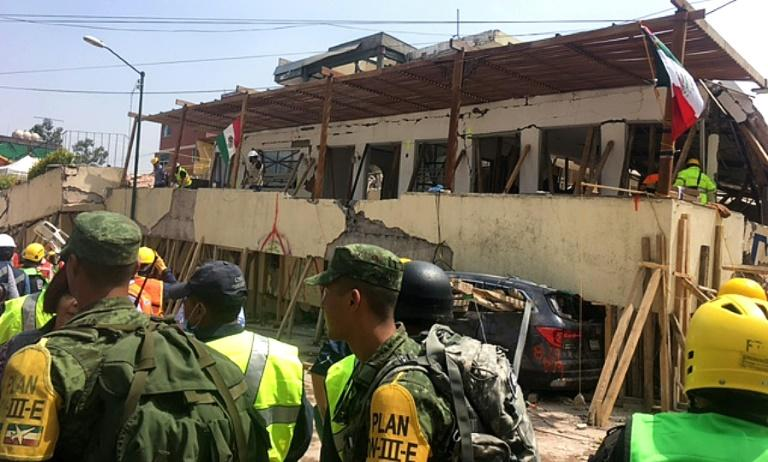Rescue teams work at the severely damaged Rebsamen school