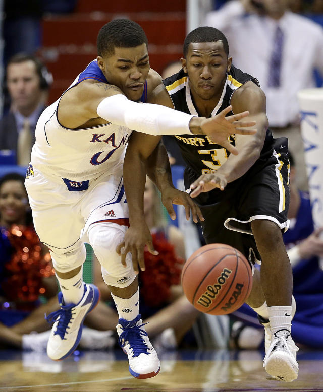 Kansas guard Frank Mason, left, and Fort Hays State's Craig Nicholson (3) chase a loose ball during the first half of an exhibition NCAA college basketball game Tuesday, Nov. 5, 2013, in Lawrence, Kan. (AP Photo/Charlie Riedel)
