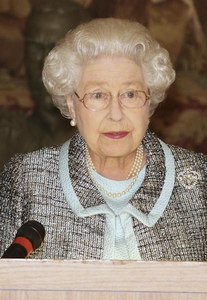 Britain's Queen Elizabeth II, Head of the Commonwealth signs the Commonwealth Charter at a reception at Marlborough House, London Monday March 11, 2013. The Charter is an historic document which brings together, for the first time in the associations 64-year history, key declarations on Commonwealth principles. (AP Photo/ Philip Toscano/PA) UNITED KINGDOM OUT