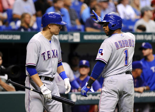 Texas Rangers' Elvis Andrus, right, celebrates with teammate Jeff Baker after scoring off of Alex Rios' single during the first inning of a baseball game Thursday, Sept. 19, 2013, in St. Petersburg, Fla. (AP Photo/Brian Blanco)