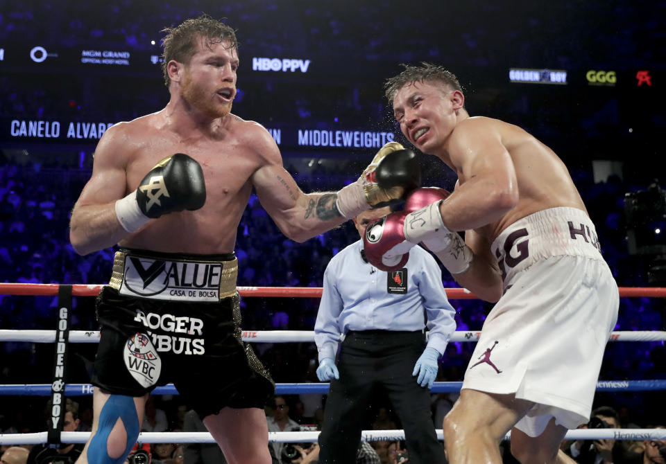 Canelo Alvarez lands a left hand in his win over Gennady Golovkin in September. (AP)