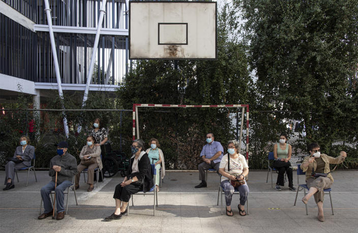 Image: People wait to get their second doses of China's Sinovac vaccine in Santiago, Chile, last month. (Esteban Felix / AP file)