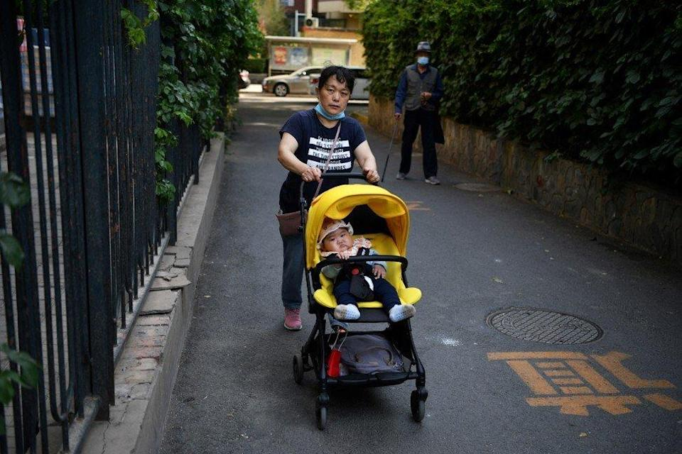 As the cost of raising a child rises, many Chinese people are delaying having children. Photo: AFP