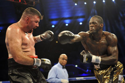 Deontay Wilder (R) roughs up Nicolai Firtha. (USA TODAY Sports)