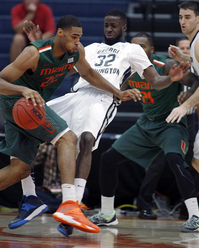 George Washington's Isaiah Armwood (32) is called for a foul defending against Miami's Donnavan Kirk, left, in the first half of an NCAA college basketball game at the Wooden Legacy tournament, Thursday, Nov. 28, 2013, in Fullerton, Calif. (AP Photo/Alex Gallardo)