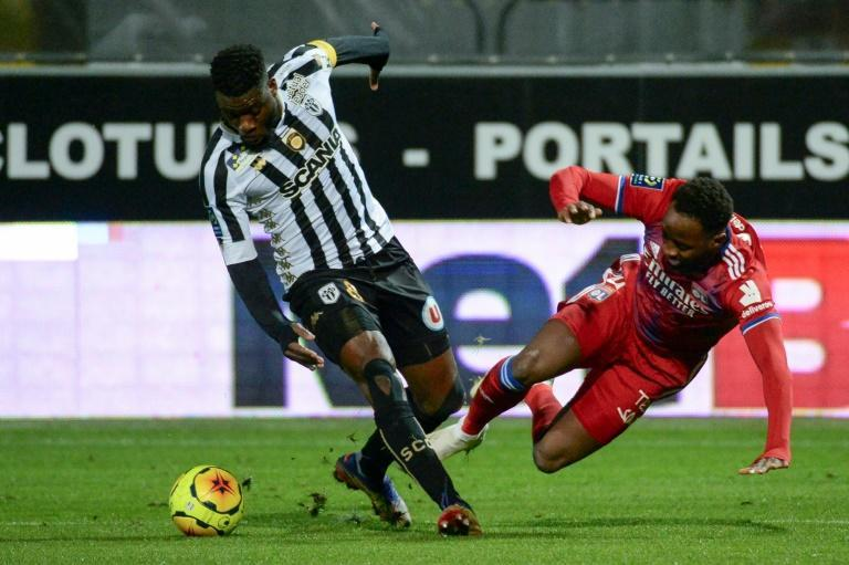 Lyon jumped into second in Ligue 1 with a narrow win at Angers
