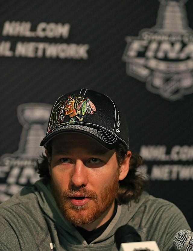 CHICAGO, IL - JUNE 11: Duncan Keith #2 of the Chicago Blackhawks answers questions during the 2013 NHL Stanley Cup media day at the United Center on June 11, 2013 in Chicago, Illinois. (Photo by Jonathan Daniel/Getty Images)