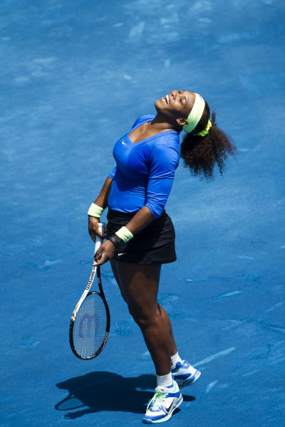 Serena Williams from U.S. celebrates a point on her way to defeat Maria Sharapova from Russia during the Madrid Open tennis tournament, in Madrid, Friday, May 11, 2012. (AP Photo/Daniel Ochoa de Olza)