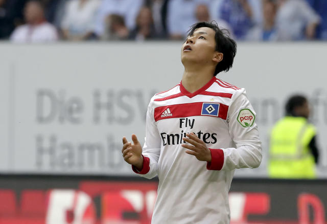 Hamburg's Tatsuya Ito reacts during the German Bundesliga soccer match between Hamburger SV and VfL Borussia Moenchengladbach in Hamburg, Germany, Saturday, May 12, 2018. (AP Photo/Michael Sohn)