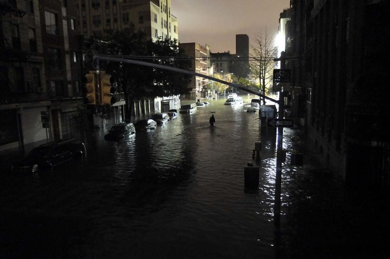 NEW YORK, NY - OCTOBER 30: A general view of submerged cars on Ave. C and 7th st, after severe flooding caused by Hurricane Sandy, on October 30, 2012 in Manhattan, New York. The storm has claimed at least 16 lives in the United States, and has caused massive flooding across much of the Atlantic seaboard. US President Barack Obama has declared the situation a 'major disaster' for large areas of the US East Coast including New York City, with wide spread power outages and significant flooding in parts of the city. (Photo by Christos Pathiakis/Getty Images)