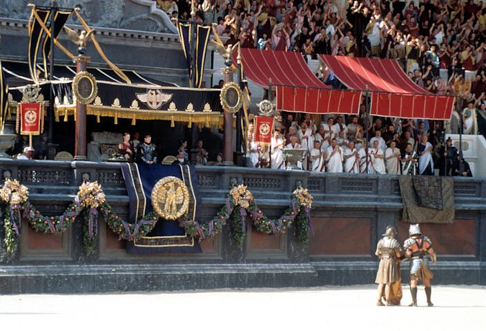 Connie Nielsen and Joaquin Phoenix looking with crowd out over the gladiatorial arena in a scene from the film 'Gladiator', 2000. (Photo by Universal/Getty Images)