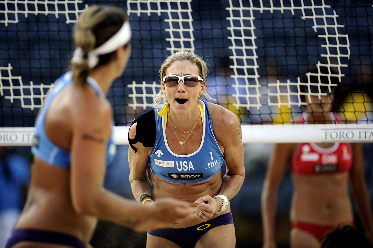 US Kerri Walsh (C) celebrates with teammate Misty May-Treanor during their FIVB Beach Volleyball World Championships semifinals against China in Rome's Foro Italico on June 18, 2011.   AFP PHOTO / Filippo MONTEFORTE (Photo credit should read FILIPPO MONTEFORTE/AFP/Getty Images)