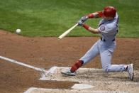 St. Louis Cardinals' Tommy Edman hits an RBI double during the fifth inning of the first game of a baseball doubleheader against the Milwaukee Brewers Wednesday, Sept. 16, 2020, in Milwaukee. (AP Photo/Morry Gash)