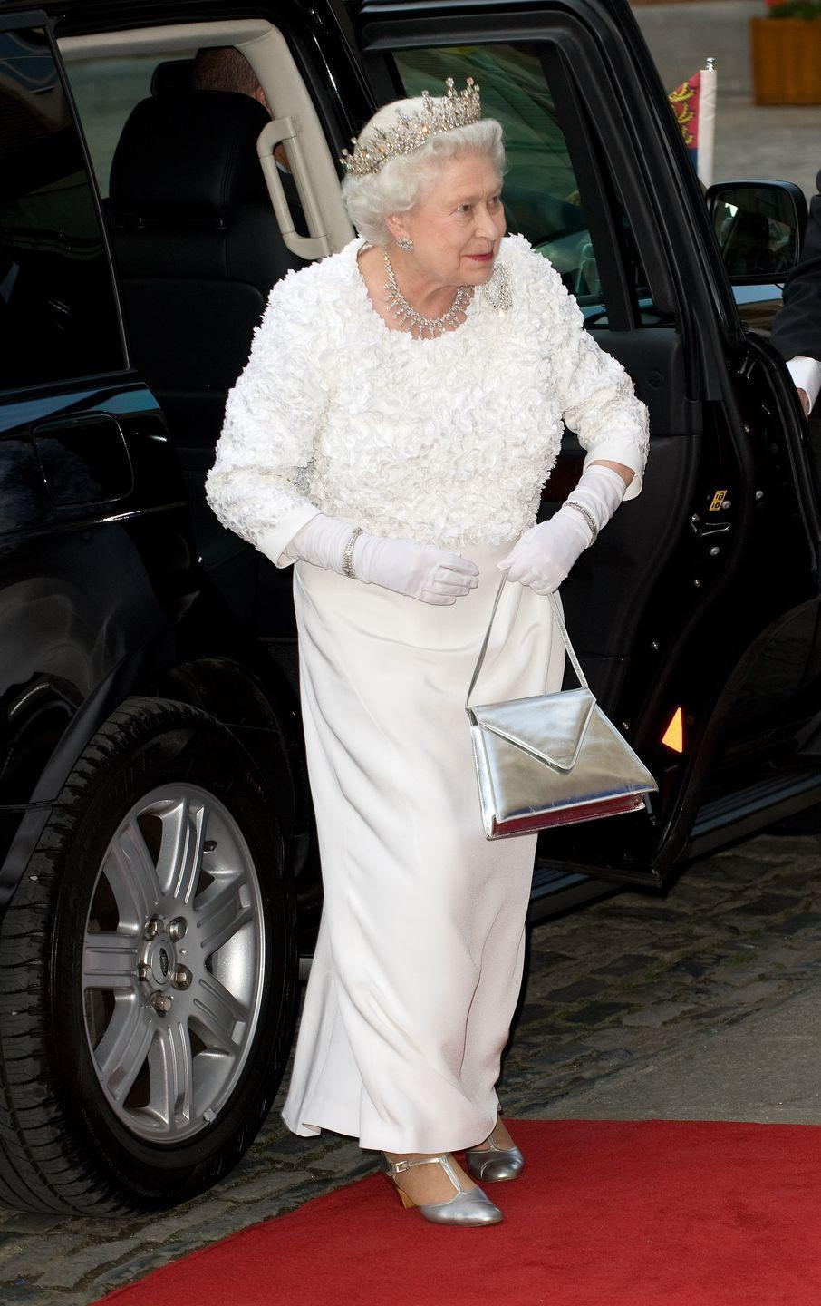 """<p>The Queen paid tribute to her host country while on a royal visit to Ireland. <a href=""""https://www.royalcollection.org.uk/collection/themes/exhibitions/fashioning-a-reign/windsor-castle/evening-dress-9?language=en"""" rel=""""nofollow noopener"""" target=""""_blank"""" data-ylk=""""slk:The white evening dress"""" class=""""link rapid-noclick-resp"""">The white evening dress</a> was embellished with chiffon shamrocks, the national emblem of Ireland.</p>"""