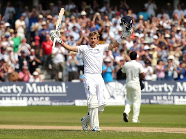 England's Joe Root celebrates reaching his hundred during the fourth day of the first Test against India at Trent Bridge in Nottingham, central England, on July 12, 2014 (AFP Photo/Andrew Yates)