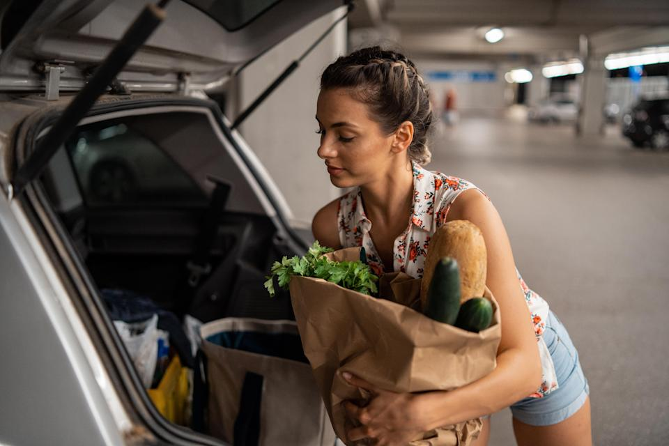 An ex-MLM distributor shares how she was told to drum up sales by approaching strangers in supermarket parking lots and offer to load their cars with groceries. (Photo: Getty)