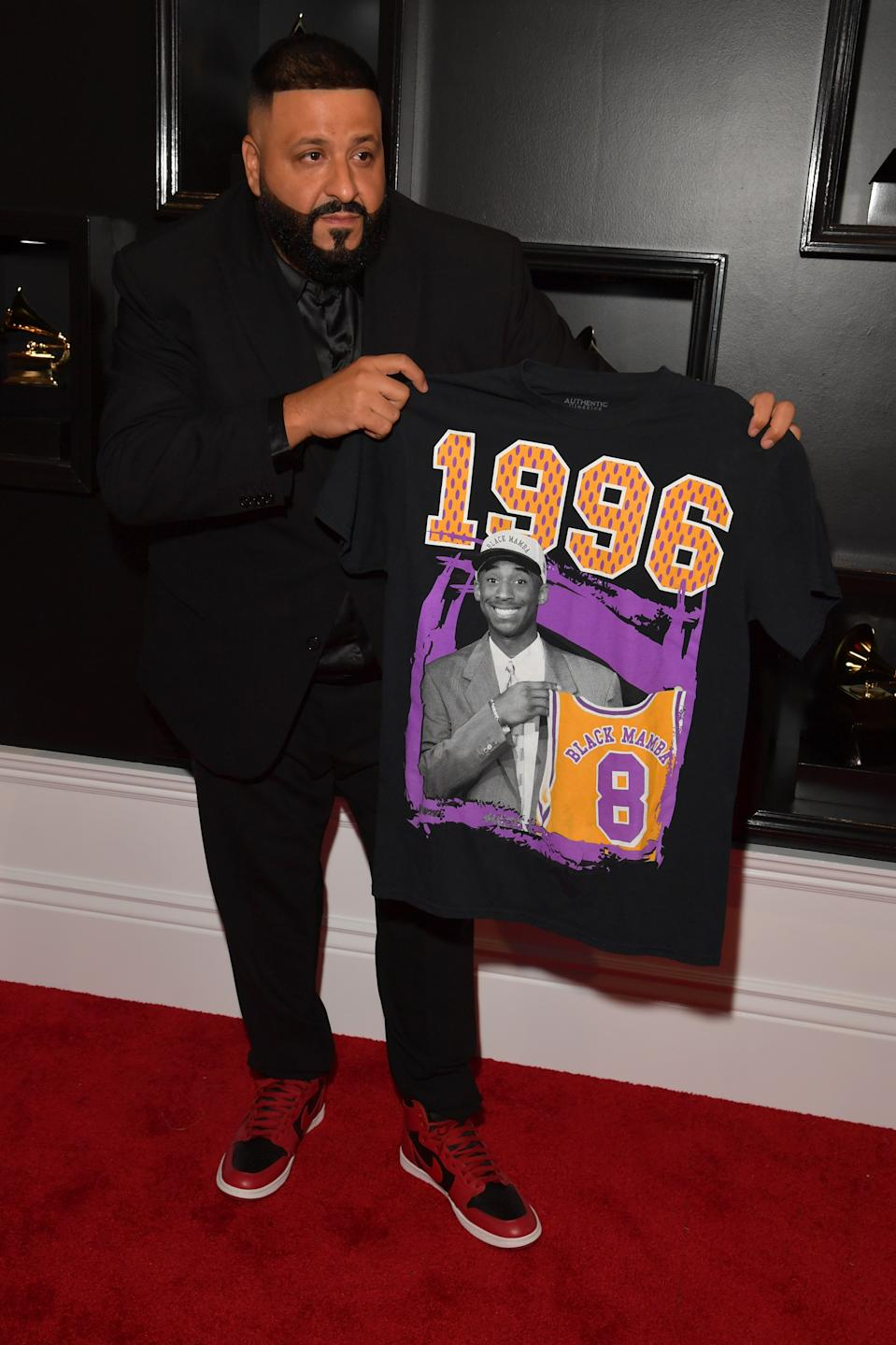 """The """"Higher"""" rapper was one of several stars to pay tribute to Kobe Bryant on the red carpet. Hours before the Grammys broadcast, it was announced that Bryant and his 13-year-old daughter Gianna were killed in a helicopter crash in Calabasas, Calif. Khaled carried a T-shirt of Bryant, posing with a Lakers jersey emblazoned with his nickname, """"Black Mamba."""""""