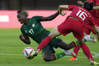 Zambia's Racheal Kundananji (17) collides with China's Wang Xiaoxue (16) during a women's soccer match at the 2020 Summer Olympics, Saturday, July 24, 2021, in Miyagi, Japan. (AP Photo/Andre Penner)