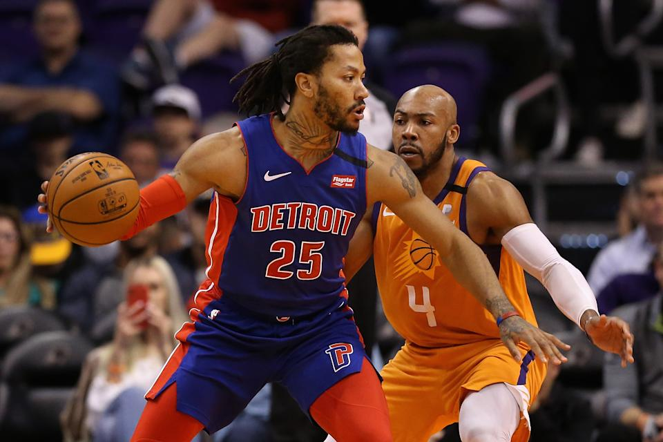 PHOENIX, ARIZONA - FEBRUARY 28: Derrick Rose #25 of the Detroit Pistons handles the ball against Jevon Carter #4 of the Phoenix Suns during the second half of the NBA game at Talking Stick Resort Arena on February 28, 2020 in Phoenix, Arizona. The Pistons defeated the Suns 113-111. NOTE TO USER: User expressly acknowledges and agrees that, by downloading and or using this photograph, user is consenting to the terms and conditions of the Getty Images License Agreement. Mandatory Copyright Notice: Copyright 2020 NBAE. (Photo by Christian Petersen/Getty Images)