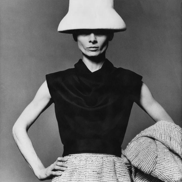 <p>Hepburn wears a Stanley and Livingstone hat, Givenchy-designed black blouse, and tweed skirt for <em>Vogue </em>in 1963. (Photo: Getty Images) </p>