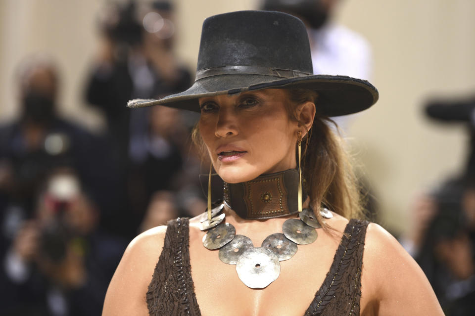 """Jennifer Lopez attends The Metropolitan Museum of Art's Costume Institute benefit gala celebrating the opening of the """"In America: A Lexicon of Fashion"""" exhibition on Monday, Sept. 13, 2021, in New York. (Photo by Evan Agostini/Invision/AP)"""
