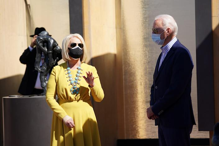 Joe Biden listens to Cindy McCain, as they pay their respects to American Indian veterans during a campaign stop at the American Indian Veterans National Memorial (REUTERS)