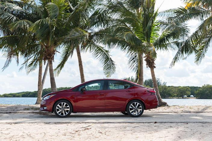 """<p>The interior inherits a much improved design and better materials that help wash away the bad taste left by the previous model's drab cabin. The dashboard is essentially the same setup found on <a href=""""https://www.caranddriver.com/nissan/kicks"""" rel=""""nofollow noopener"""" target=""""_blank"""" data-ylk=""""slk:the tiny Nissan Kicks crossover"""" class=""""link rapid-noclick-resp"""">the tiny Nissan Kicks crossover</a>, which includes a partially digital gauge cluster and a standard 7.0-inch touchscreen infotainment system. </p>"""
