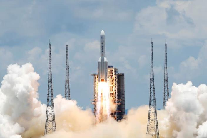 FILE PHOTO: Long March 5 Y-4 rocket carrying unmanned Mars probe of Tianwen-1 mission takes off in Wenchang