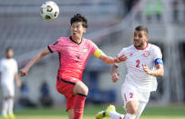 South Korea's Son Heung-min, left, fights for the ball against Lebanon's Kassem El Zein during their Asian zone Group H qualifying soccer match for the FIFA World Cup Qatar 2022 at Goyang stadium in Goyang, South Korea, Sunday, June 13, 2021. (AP Photo/Lee Jin-man)