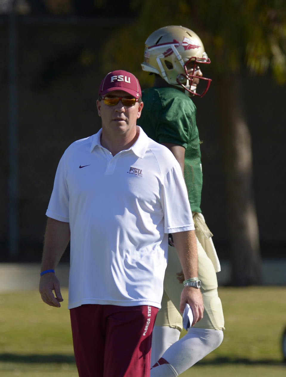 Florida State head coach Jimbo Fisher, left, looks on along with quarterback Jameis Winston during practice for their BCS Championship game against Auburn, Thursday, Jan. 2, 2014, in Costa Mesa, Calif. (AP Photo/Mark J. Terrill)