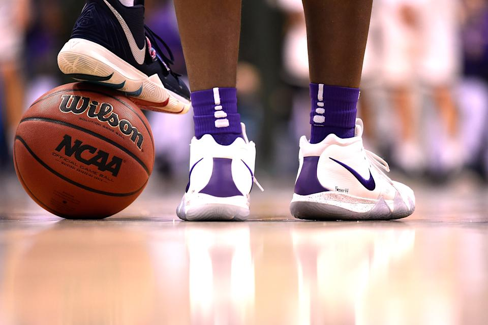 A Wilson basketball is seen as players of the LSU Tigers stand for the National Anthem prior to their game against the Michigan State Spartans during the 2019 NCAA Men's Basketball Tournament East Regional Semifinals at Capital One Arena on March 29, 2019 in Washington, DC. (Photo by Lance King/Getty Images)