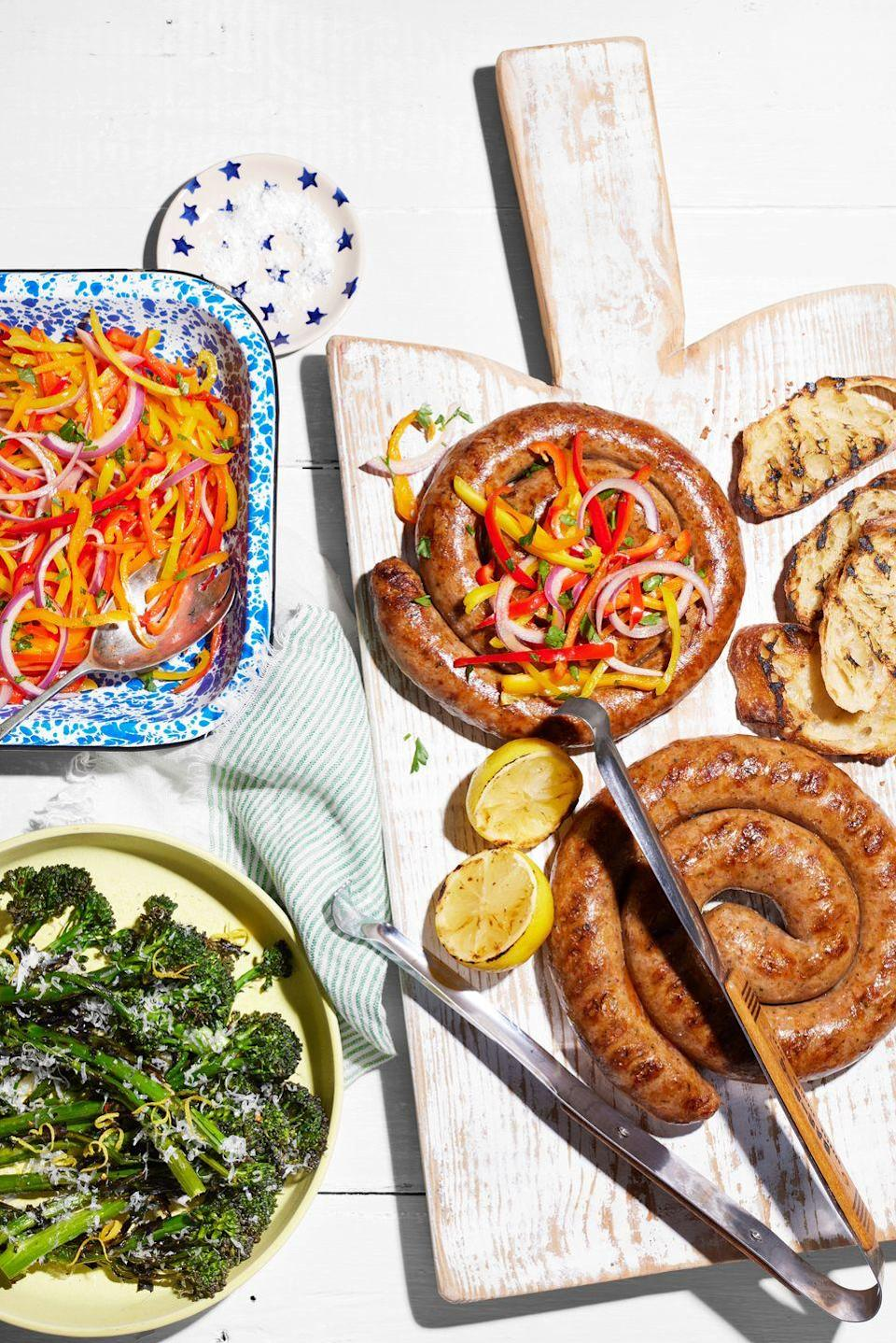"""<p>These impressive sausages are a breeze to grill, and easily feed a crowd. Pair them with greens and peppers for a full meal.</p><p><strong><a href=""""https://www.countryliving.com/food-drinks/a36744267/sausage-pinwheels-with-marinated-peppers-and-grilled-broccolini-recipe/"""" rel=""""nofollow noopener"""" target=""""_blank"""" data-ylk=""""slk:Get the recipe"""" class=""""link rapid-noclick-resp"""">Get the recipe</a>.</strong></p>"""