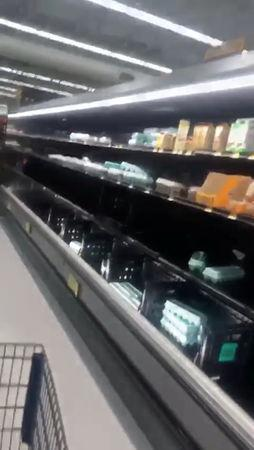 Half empty shelves are seen at a supermarket as residents prepare for Storm Florence's descent in Columbia, South Carolina, U.S., September 10, 2018, in this still image taken from a video obtained from social media. @missgil/via REUTERS