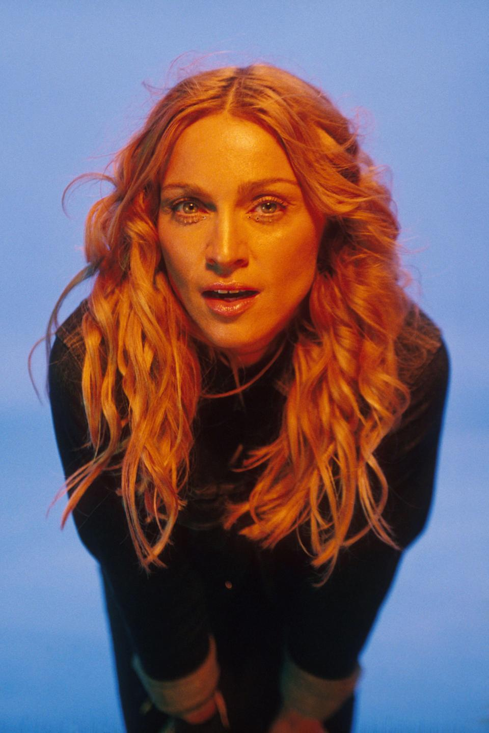 """<p>Radical reinvention number we-lost-count: 1998 <em>Ray of Light</em> Madonna. The single, 40-year-old new mom (to Lourdes) dropped her most personal and sonically innovative album, in which she muses about motherhood, fame, and the devastating, early death of her own namesake mother — all grounded in a new spiritual outlook inspired by <a href=""""https://www.ibtimes.co.uk/kabbalah-strange-ancient-jewish-mysticism-that-madonna-popularised-1507927"""" rel=""""nofollow noopener"""" target=""""_blank"""" data-ylk=""""slk:her immersion in Kabbalah"""" class=""""link rapid-noclick-resp"""">her immersion in Kabbalah</a>, an ancient, mystical form of Judaism. (Side note: her Botticelli beach hair! Her dewy skin!)</p><p>""""It's a belief system that gives you tools to deal with life. Many of its principles resemble concepts in Christianity or in Buddhism,"""" <a href=""""http://www.oprah.com/omagazine/oprah-interviews-madonna/all"""" rel=""""nofollow noopener"""" target=""""_blank"""" data-ylk=""""slk:Madonna explained to Oprah Winfrey in 2005"""" class=""""link rapid-noclick-resp"""">Madonna explained to Oprah Winfrey in 2005</a>. """"I've never felt more creative. One thing I've learned is that I'm not the owner of my talent, I'm the manager of it. And if I learn how to manage my talent correctly — and if I accept that I'm just channeling things that come from God — the talent will keep flowing through me.""""</p><span class=""""copyright"""">Photo: Frank Micelotta Archive/Getty Images.</span>"""