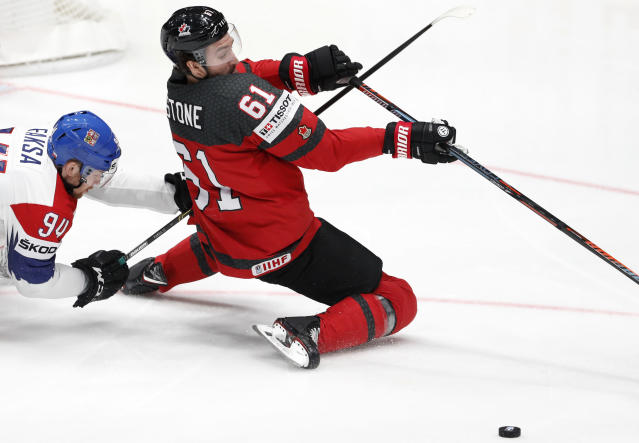 Czech Republic's Radek Faksa, left, challenges Canada's Mark Stone during the Ice Hockey World Championships semifinal match between Canada and Czech Republic at the Ondrej Nepela Arena in Bratislava, Slovakia, Saturday, May 25, 2019. (AP Photo/Petr David Josek)
