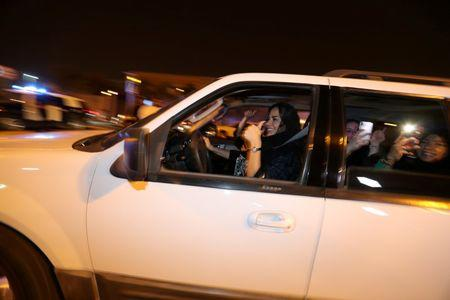 FILE PHOTO: A Saudi woman celebrates with her friends as she drives her car in Al Khobar