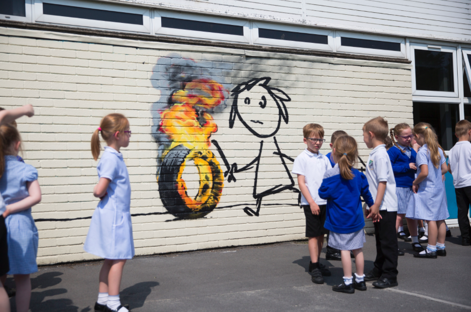 Banksy sneaks into school over half term to paint kids for Banksy mural painted over