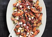 "Make this roasted butternut squash ahead of time: It's great at room temperature, and you'll need the oven free to roast the potatoes. <a href=""https://www.bonappetit.com/recipe/roasted-butternut-squash-with-spicy-onions?mbid=synd_yahoo_rss"" rel=""nofollow noopener"" target=""_blank"" data-ylk=""slk:See recipe."" class=""link rapid-noclick-resp"">See recipe.</a>"